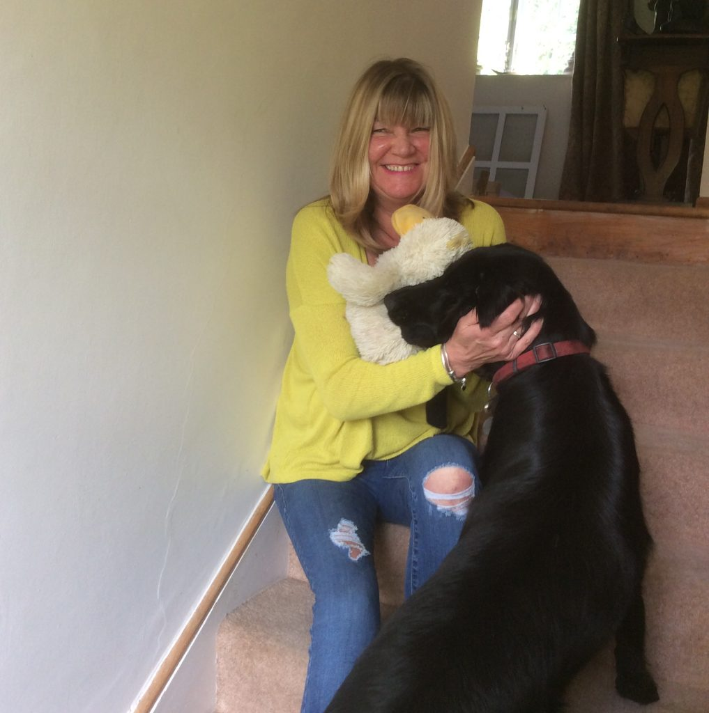 Housekeeper Nikki with Ann's dog Tilly